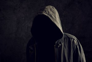 A faceless man without an identity wearing a hooded jacket